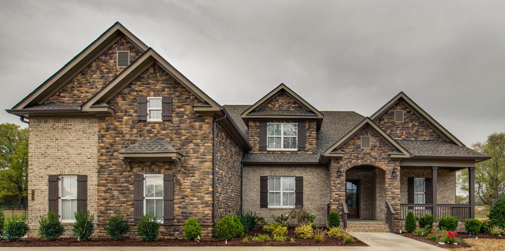 Bridgemore village for Brick houses with stone accents